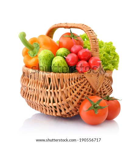 Organic vegetables in the wicker basket isolated on white background