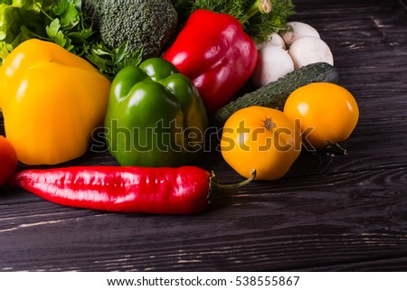 organic vegetables on a wooden background