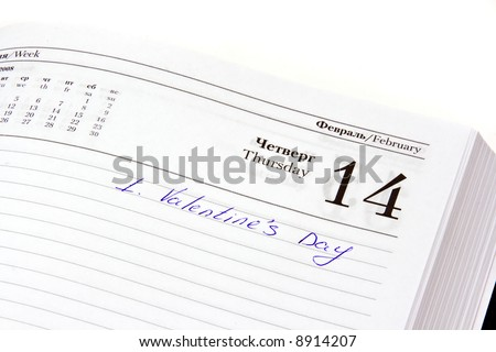 Organizer open on the Valentine's day date with mark written by hand