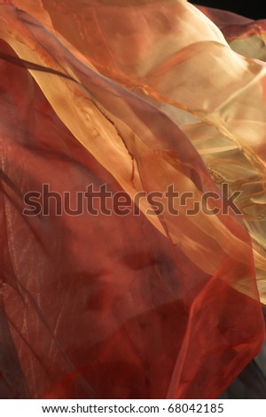 ... . Light silk fabric of different colors. Background. - stock photo