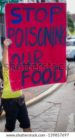 ORLANDO, FL-MAY 25:  Protesters rallied in the streets against the Monsanto corporation. The company is accused of genetically modifying foods unsafely. May 25, 2013 in Orlando, Florida.