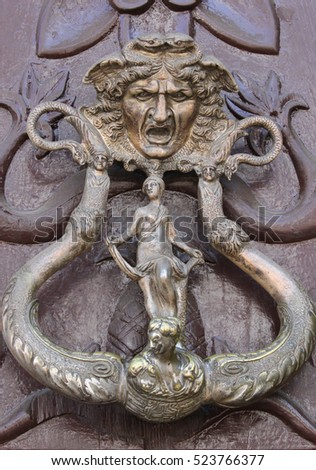 Ornate Door Knocker With Mythical Figures In Bolivia