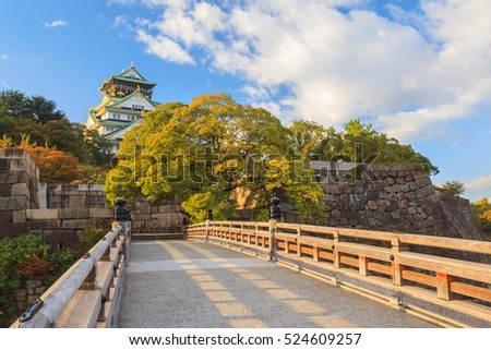 Osaka Castle with wooden bridge in autumn season leaf, Unesco landmark at Osaka, Japan