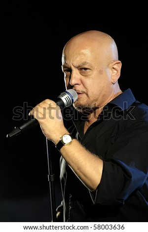 OSPITALETTO ,ITALY - JULY 25: the concert live of the italian pop singer Enrico Ruggeri,25 July,2010 in Ospitaletto (Bs),Italy