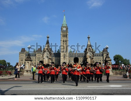 OTTAWA, CANADA - AUGUST 4: Ceremonial Guards leaving Parliament Hill during a Changing of the Guard Ceremony on August 4, 2012 in Ottawa, Ontario. The event occurs each morning during the summer.