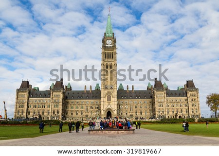 OTTAWA, CANADA -  11TH OCTOBER 2014: The houses of parliament in Ottawa from the front. People can be seen outside