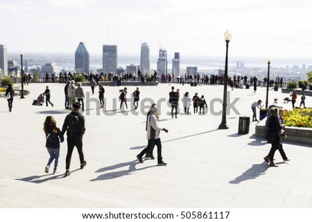 Out of focus shot of tourists overlooking the Montreal city skyline.