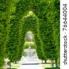 Outdoor Park Archways over a Paved Path on a Sunny Day - stock photo