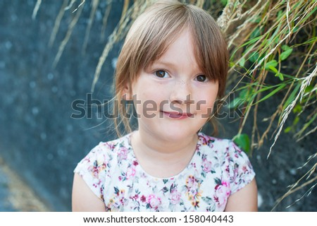 Outdoor portrait of a beautiful little girl close-up