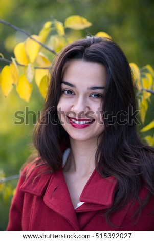 Outdoor portrait of a beautiful young brunette woman