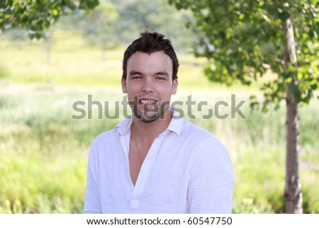 outdoor portrait of a cute young man
