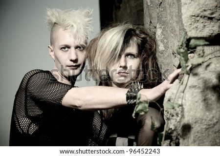outdoor portrait of a goth punk couple