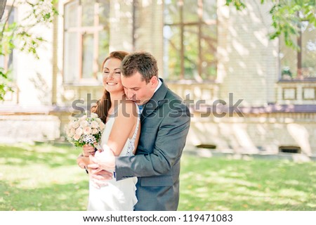 outdoor portrait of beautiful happy couple