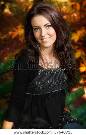 Outdoor portrait of cute young woman in autumn