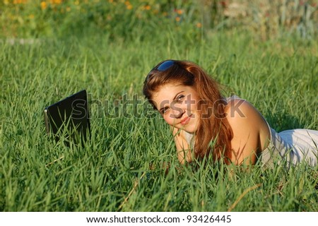 Outdoor portraits of beautiful girl with notebook.Ukraine