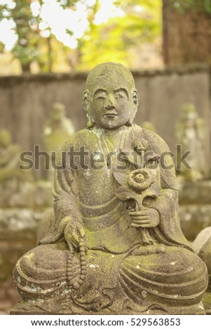 outdoor sculpture of japanese monk