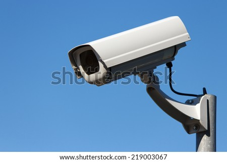 Outdoor surveillance cam and blue sky background with copy space