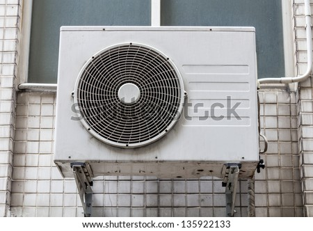Outdoor Unit of Airconditioner compressor on the Wall