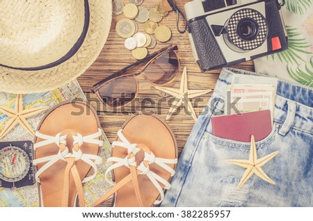 Outfit of traveler on wooden table