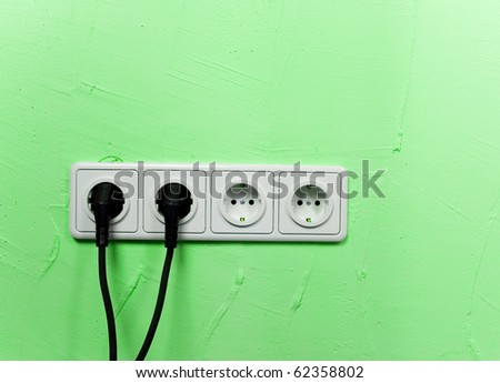 outlet on green wall