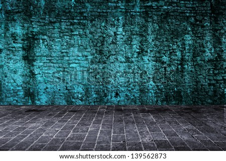 Outside blue wall with ground