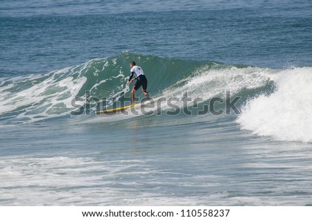 OVAR, PORTUGAL - AUGUST 19: Unidentified surfer at 1st stage of National Longboard Championship  on august 19, 2012 in Ovar, Portugal.