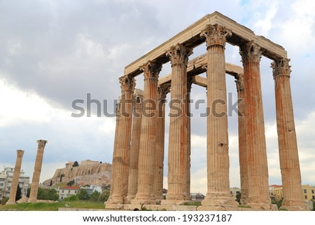 Overcast sky cover tall columns of the temple of Zeus in Athens, Greece