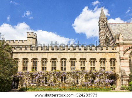 Oxford, UK - May 15, 2016; Interior facade of Balliol College with gardens full of lilacs