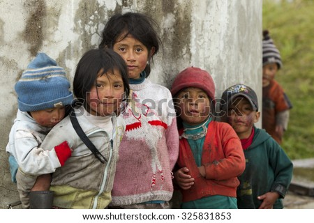 Ozogoche, Ecuador - 19 December 2011: Group Of Dirty And Poorly Dressed Kids Due To The Lack Of Education And Basic Hygiene Services Living In A Rural Area In Ozogoche On December 19, 2011