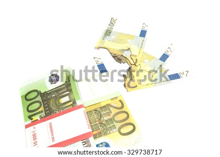pack of euros and burned banknotes on white