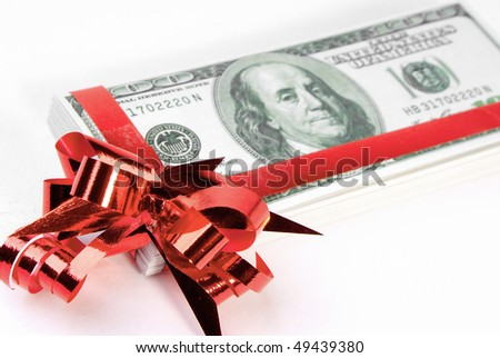 Pack of the American money as a gift on white background