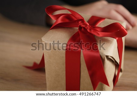 packed gift box with red ribbon and bow