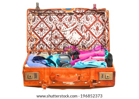 Packed leather suitcase fdr a beach vacation