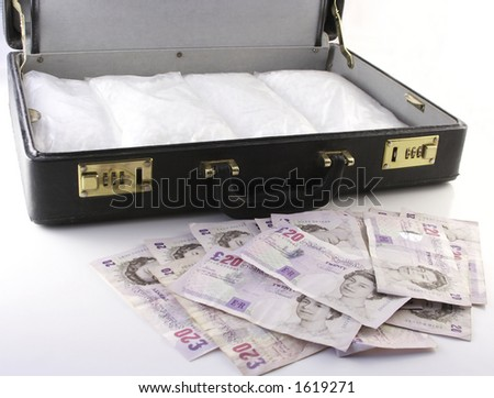 packets of crack in attache case with money in foreground