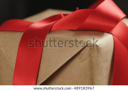 packing presents with red ribbon