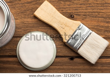 paintbrush wood coating tool equipment wood teak still life background vintage closeup
