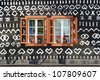 Painted old wooden cottage with window - stock photo