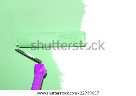painting a wall with a roll in green