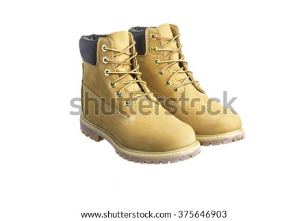 Pair of beige leather work boots isolated on white