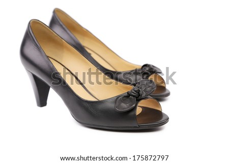 Pair of black woman shoes. Isolated on a white background.