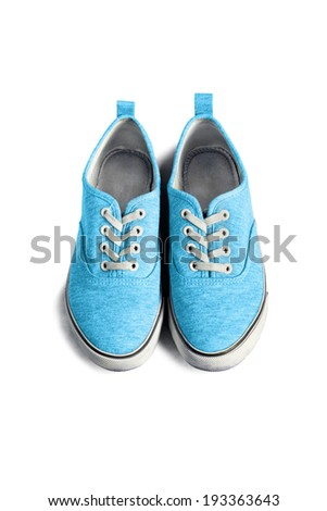 Pair of blue textile sneakers on white background