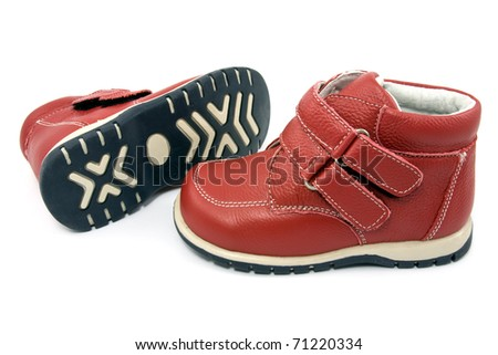 Pair of  child's red  shoes over white background