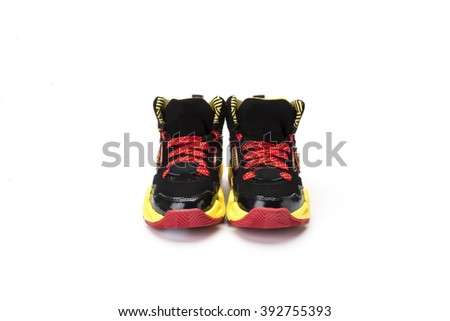 Pair of childs ankle boot running shoe, sneaker or trainer in red and yellow design shot at a 3/4 angle on a white background