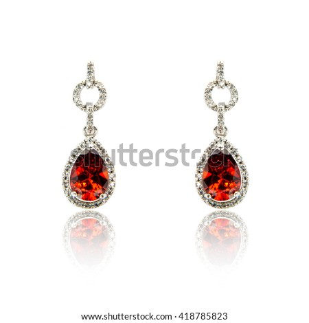 Pair of diamond earrings isolated on white