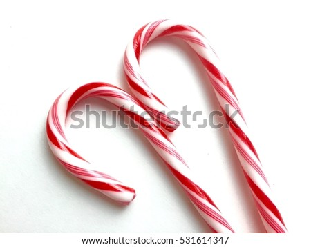 Pair of red and white candy canes