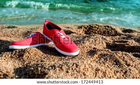 Pair of shoes on the sandy coast