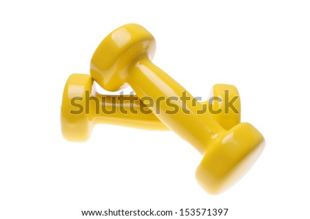 Pair of small yellow dumbbells Isolated on white background.
