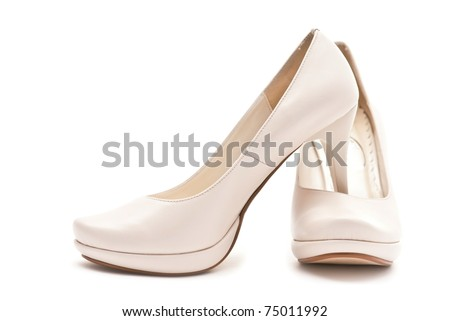 Pair of white female shoes isolated on white