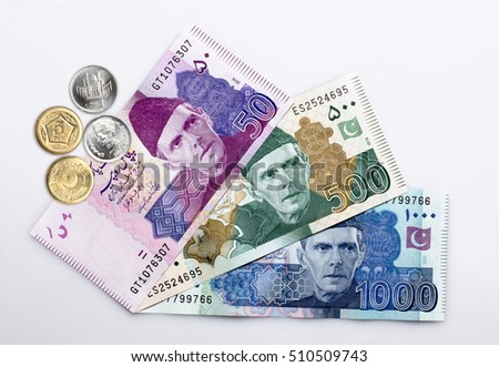 Pakistani Currency Banknote with coins