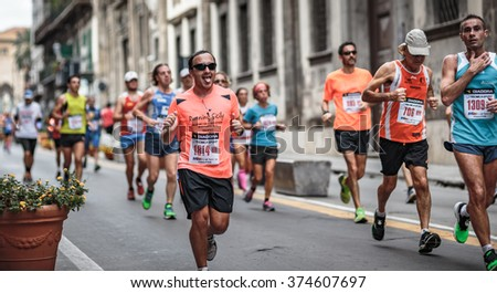 PALERMO, ITALY - NOVEMBER 10 2015: Marathon in Palermo on a warm November morning. People running in the old town of the Sicilian Capital of Italy